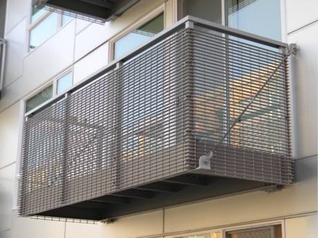 Steel grating infill panels are used as fences in the balcony.