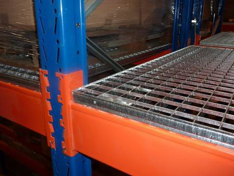 A part of carbon steel shelf rack supported by vertical blue brackets and horizontal orange brackets.