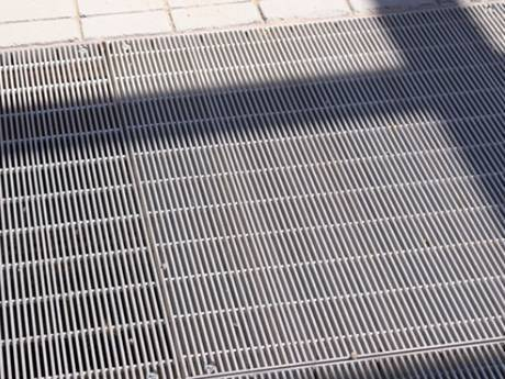 Dense steel grating as floors fir people to walk.