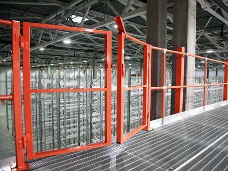 Dense steel grating used as platform in the warehouse of factory.