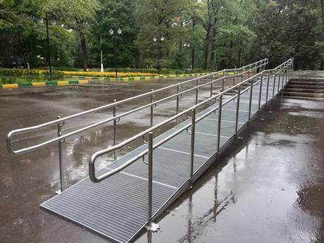 Dense steel grating used as slope in a park.