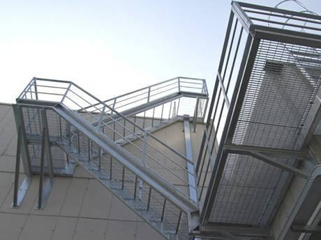The welded steel grating stairs setting in the exterior of the building.