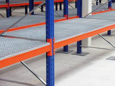 A part of galvanized steel shelf rack supported by vertical blue brackets and horizontal orange brackets.