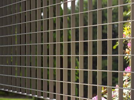 Welded steel grating infill panels are used as fences of garden.