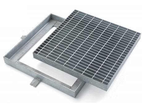A square gully and well cover made of steel grating.