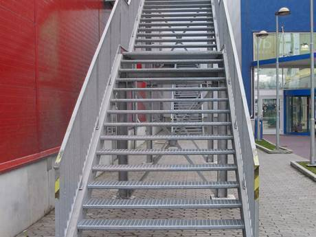The Height Adjustable Stair Connects With The Red Warehouse.
