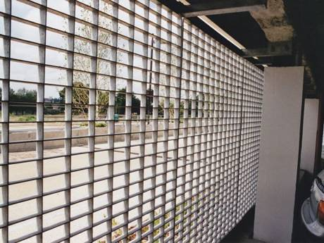 Steel grating infill panels are used as fences of the parking garage.