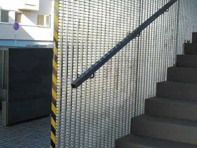 Steel Grating Panels Separate The Stairs From The Outdoor Area.