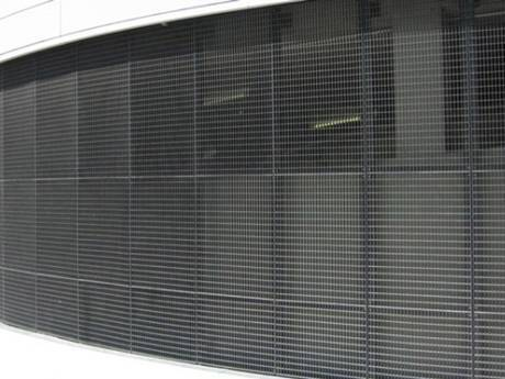 The black press-locked steel grating used as the outer wall decoration of a building.
