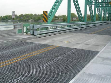 This a huge bridge with riveted grating bridge decking.