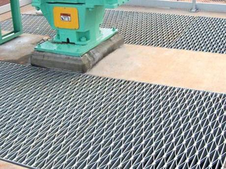 This is a operating platform with riveted grating.