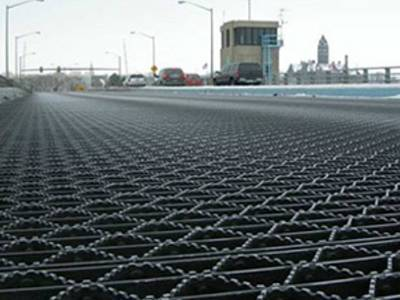 This is riveted grating with serrated surface.