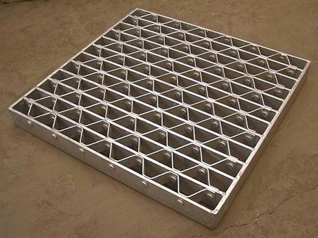 This is a well cover made of riveted grating.