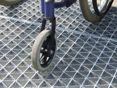 A small bicycle is passing riveted grating walkway.