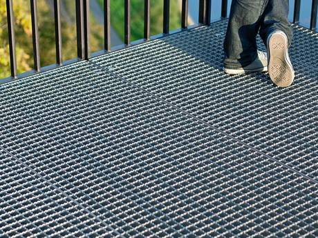 Serrated welded steel grating used to prevent people from slipping on the balcony.