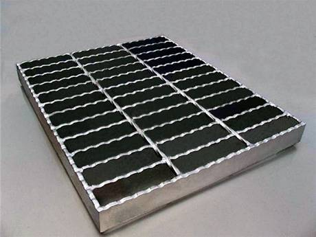 A piece of steel grating infill panel with serrated surface and end plates.