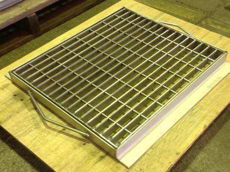 This is a swage locked grating trench covers on the desk.